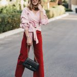 red striped wrap top and red crop jeans