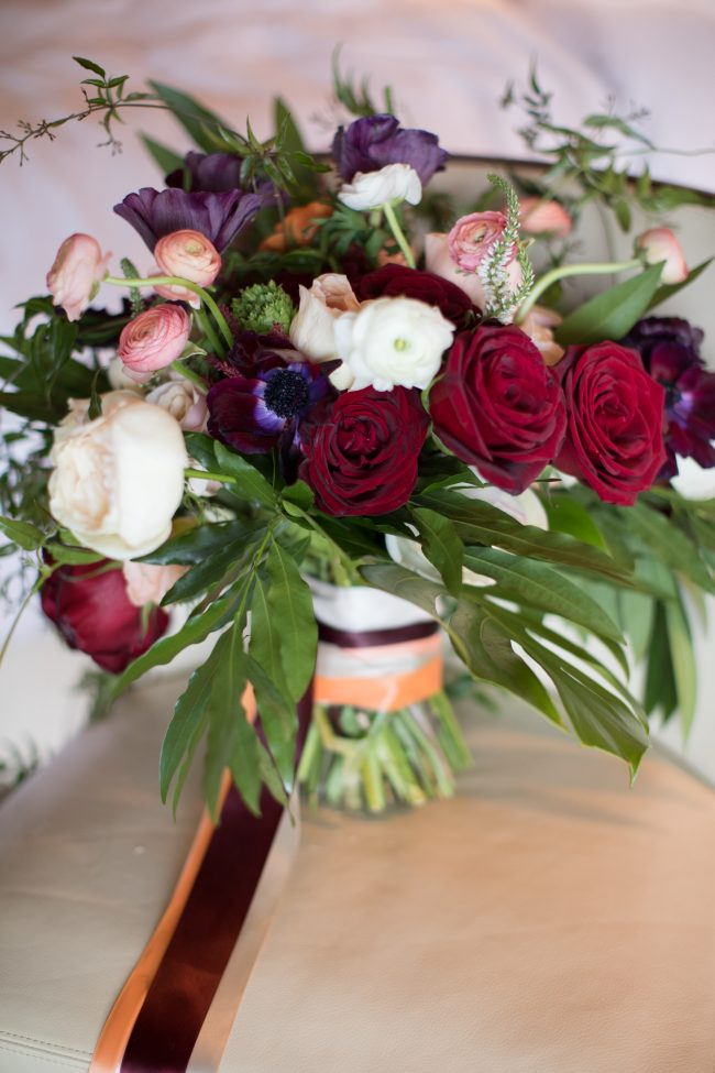 tropical-wedding-flowers-red-roses-ivory-blush